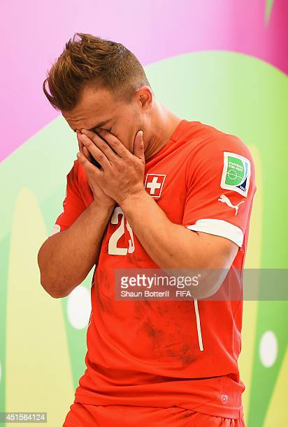 Xherdan Shaqiri of Switzerland shows his dejection in the tunnel after the 01 defeat in the 2014 FIFA World Cup Brazil Round of 16 match between...