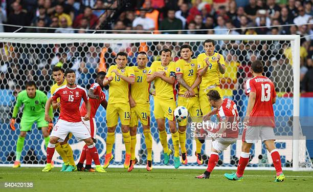 Xherdan Shaqiri of Switzerland takes a free kick during the UEFA EURO 2016 Group A match between Romania and Switzerland at Parc des Princes on June...