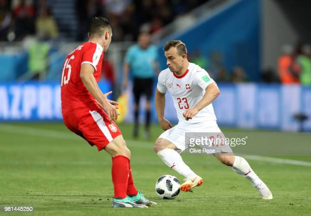 Xherdan Shaqiri of Switzerland takes on Nikola Milenkovic of Serbia during the 2018 FIFA World Cup Russia group E match between Serbia and...