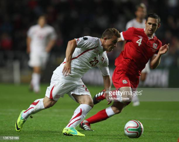 Xherdan Shaqiri of Switzerland tracked by Andrew Crofts of Wales during the EURO 2012 Qualifying Group G match between Wales and Switzerland at the...