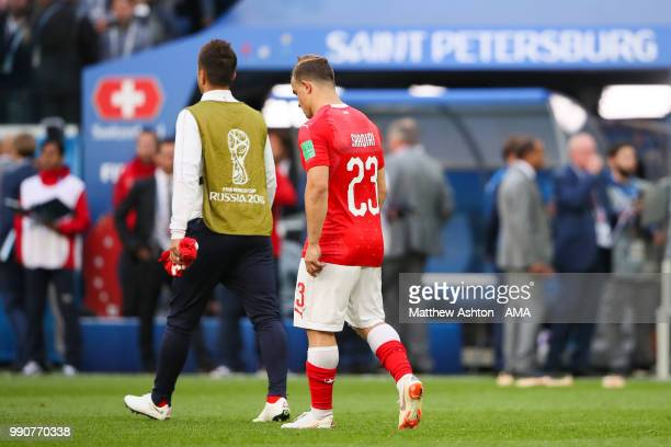 Xherdan Shaqiri of Switzerland walks off at the end of the 2018 FIFA World Cup Russia Round of 16 match between Sweden and Switzerland at Saint...