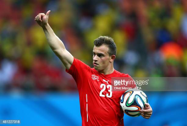 Xherdan Shaqiri of Switzerland walks off the pitch with the match ball as he completed a hat trick after the 30 win in the 2014 FIFA World Cup Brazil...