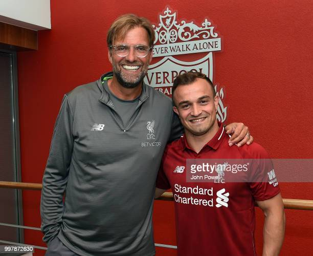 Xherdan Shaqiri with his new boss Jurgen Klopp manager of Liverpool signs for Liverpool at Melwood Training Ground on July 13 2018 in Liverpool...