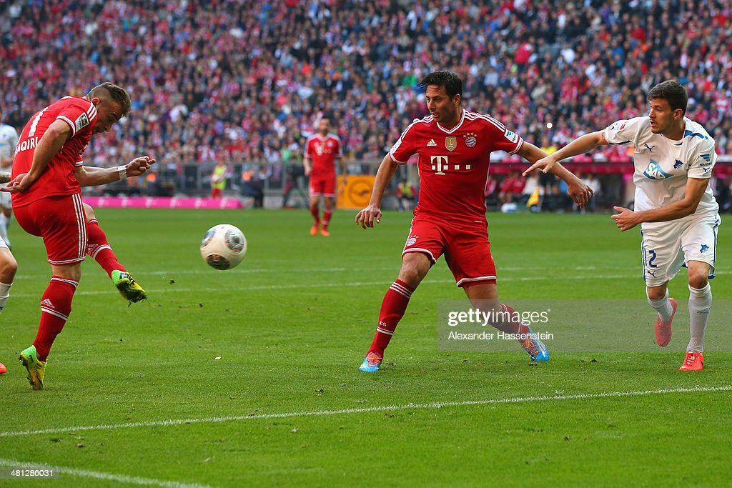 Xherdan Shaquiri (L) of Muenchen scores the second team goal during the Bundesliga match between FC Bayern Muenchen and 1899 Hoffenheim at Allianz Arena on March 29, 2014 in Munich, Germany.
