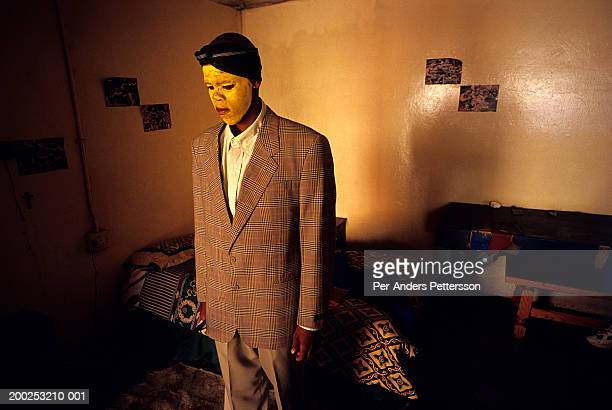 xhosa boy in his home after manhood ceremony in rural eastern cape, south africa - circumcision stock pictures, royalty-free photos & images