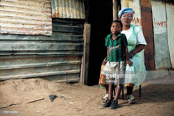 xhosa family in front of house - south african culture stock photos and pictures