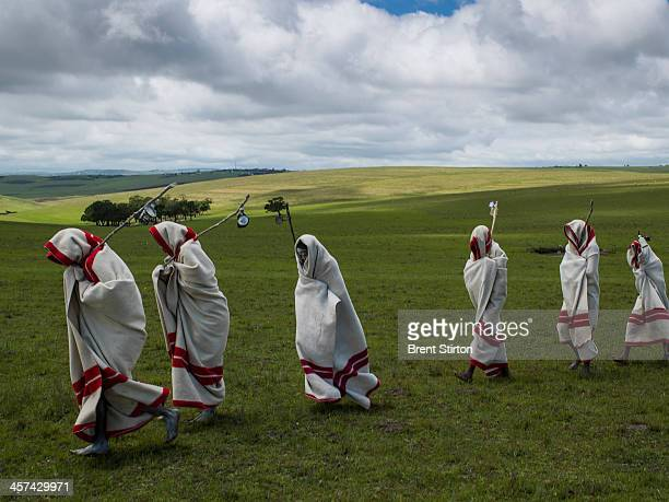 Xhosa Initiates pass by close to the funeral of Nelson Mandela Qunu South Africa 14 December 2014 These initiates have recently been circumsized...