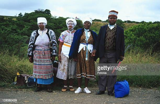 xhosa man and three woman standing at side of road - xhosa culture stock photos and pictures