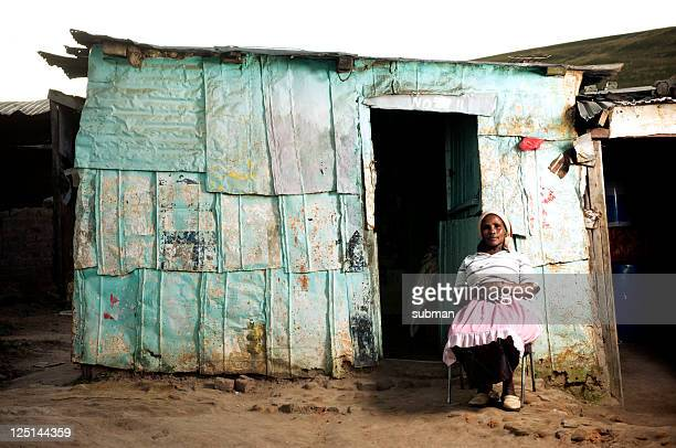 xhosa woman in front of home - eastern cape stock pictures, royalty-free photos & images