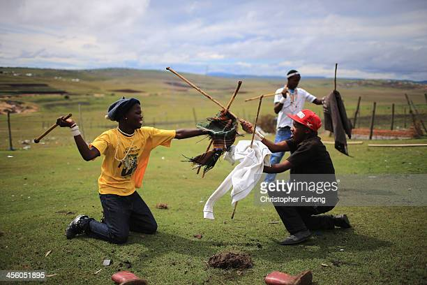 Xhosa youths fight with sticks as theytake part in a manhood ceremony in Qunu ahead of the funeral of Nelson Mandela on December 13 2013 in Qunu...