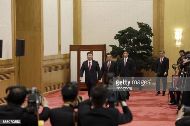 Xi Jinping China's president and general secretary of the Communist Party of China from left arrives with other members of the Communist Party's new...