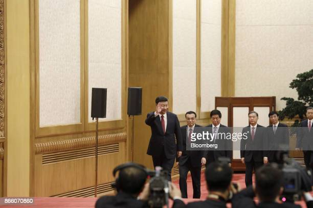 Xi Jinping China's president and general secretary of the Communist Party of China from left walks on stage with other members of the Communist...