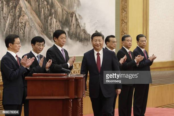 Xi Jinping China's president and general secretary of the Communist Party of China center approaches the podium as other members of the Communist...