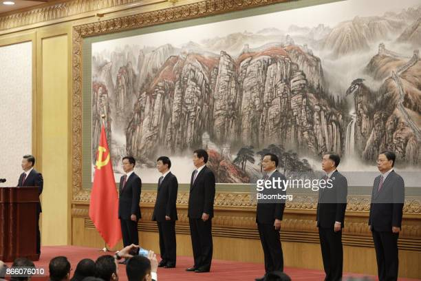 Xi Jinping China's president and general secretary of the Communist Party of China from left speaks at the podium as other members of the Communist...