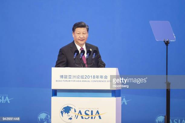 Xi Jinping China's president approaches the podium to speak at the Boao Forum for Asia Annual Conference in Boao China on Tuesday April 10 2018 Xi...