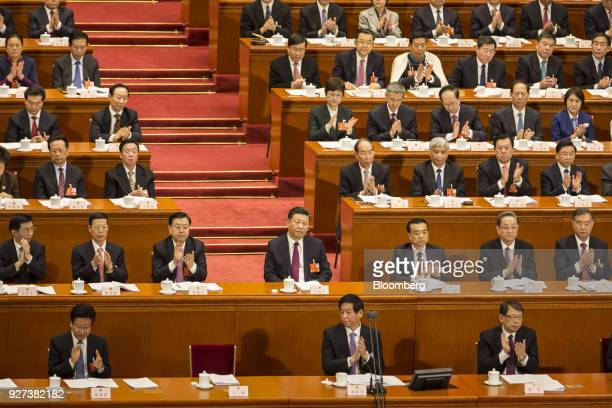 Xi Jinping China's president center looks on as Wang Huning member of the Communist Party of China's Politburo Standing Committee second row left...
