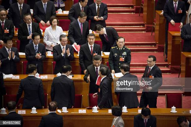 Xi Jinping China's president center reaches out to shake hands with Zhang Gaoli China's former vice premier as Li Keqiang China's premier second row...