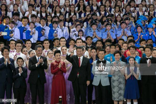 Xi Jinping China's President front row center waves as pianist Lang Lang front row left Leung Chunying Hong Kong's outgoing chief executive front row...