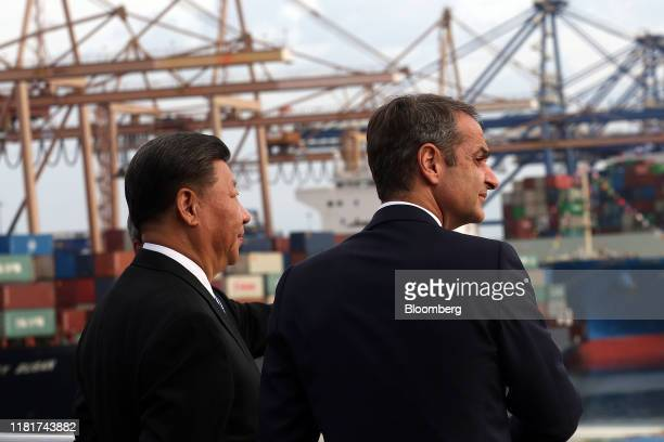 Xi Jinping, China's president, left, and Kyriakos Mitsotakis, Greece's prime minister, visit the China Ocean Shipping Co. Ltd. Container terminal at...
