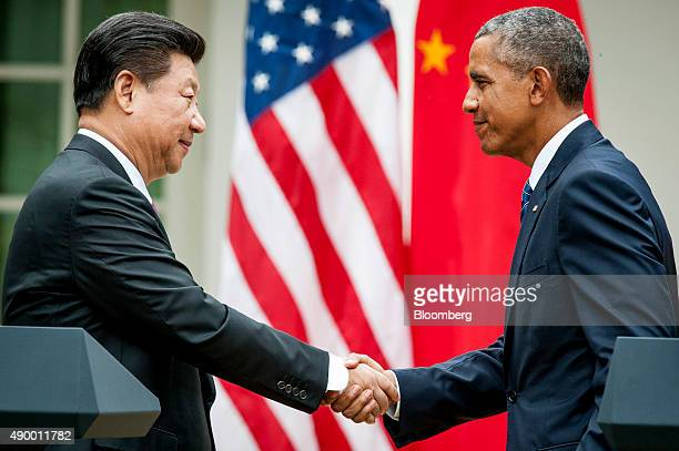 Xi Jinping China's president left shakes hands with US President Barack Obama following a joint news conference in the Rose Garden at the White House...