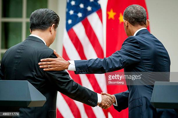 Xi Jinping China's president left shakes hands with US President Barack Obama as they depart following a joint news conference in the Rose Garden at...