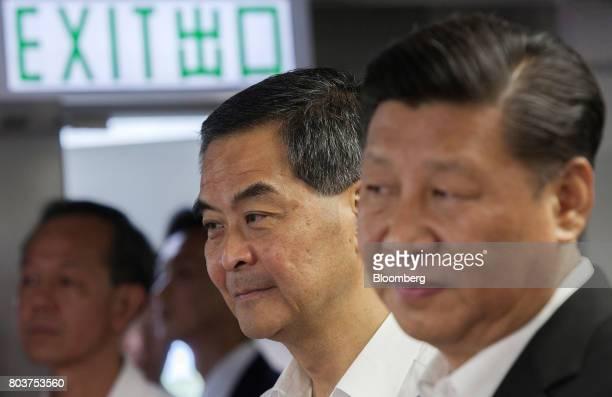 Xi Jinping China's president right and Leung Chunying Hong Kong's outgoing chief executive visit the Hong Kong Police Force's Junior Police Scheme at...