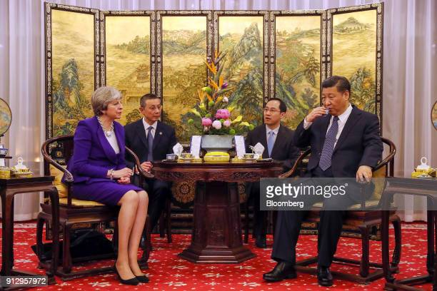 Xi Jinping China's president right drinks tea as Theresa May UK prime minister looks on during a tea ceremony at the Diaoyutai State Guest House in...