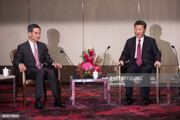 Xi Jinping China's president right speaks as Leung Chunying Hong Kong's outgoing chief executive looks on during a meeting in Hong Kong China on...