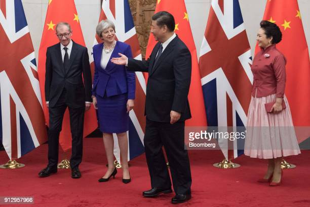 Xi Jinping China's president second right gestures to Philip May husband of UK Prime Minister Theresa May left and Theresa May UK prime minister as...