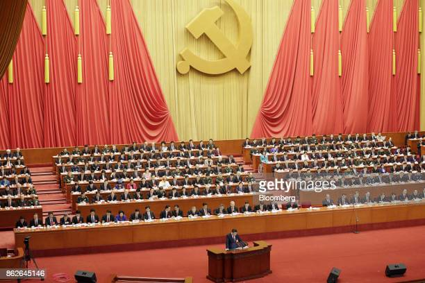 Xi Jinping, China's president, speaks at the podium during the opening of the 19th National Congress of the Communist Party of China at the Great...