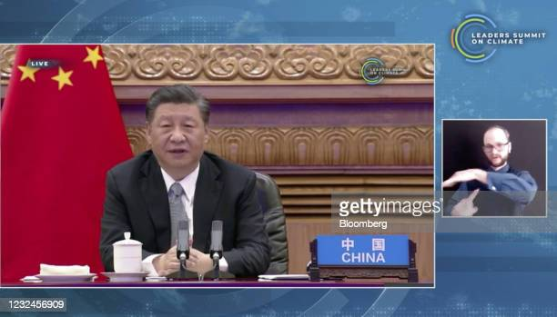 Xi Jinping, China's president, speaks during the virtual Leaders Summit on Climate in a video screenshot on Thursday, April 22, 2021. President Biden...
