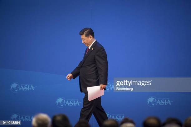 Xi Jinping China's president walks off stage after speaking at the Boao Forum for Asia Annual Conference in Boao China on Tuesday April 10 2018 Xi...