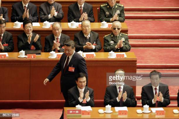 Xi Jinping, China's president,stands to speak at the opening of the 19th National Congress of the Communist Party of China at the Great Hall of the...