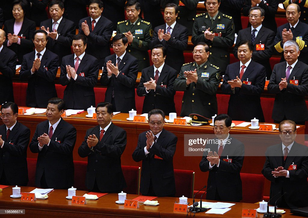 Xi Jinping, China's vice president, front row second left, Hu Jintao, China's president, front row second right, and Jiang Zemin, former president, right, clap during the closing session of the 18th National Congress of the Communist Party of China at the Great Hall of the People in Beijing, China, on Wednsday, Nov. 14, 2012. Xi and Li Keqiang were reappointed to the Chinese Communist PartyÕs Central Committee, positioning them to take over the top two posts in the worldÕs second-biggest economy. Photographer: Tomohiro Ohsumi/Bloomberg via Getty Images