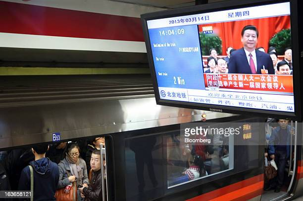Xi Jinping newly named president of China is seen during a news broadcast displayed on a television monitor at a subway station in Beijing China on...