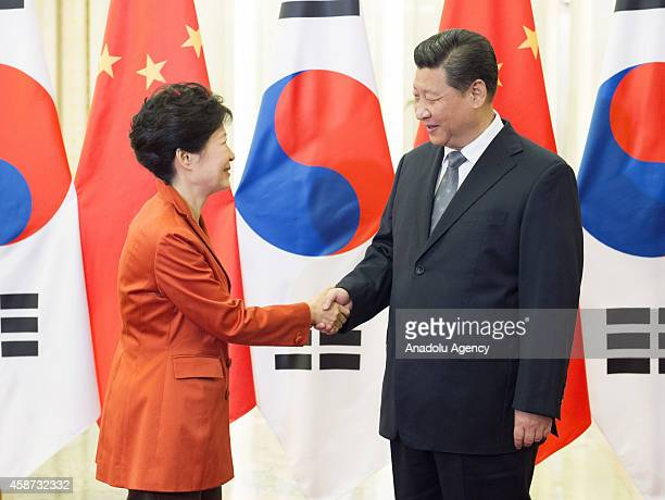Xi Jinping President of the People's Republic of China and his South Korean counterpart Park Geunhye shake hands in Beijing China on November 10 2014...