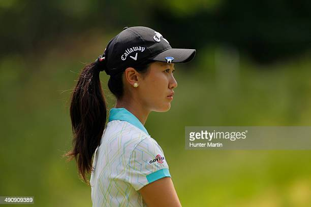 Xi Yu Lin of China stands on the green on the eighth hole during the first round of the Kingsmill Championship presented by JTBC on the River Course...