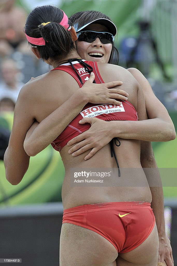 Xi Zhang (R) and Chen Xue (R) from China celebrate their victory during the match between China and Vanuatu during Day 5 of the FIVB World Championships on July 5, 2013 in Stare Jablonki, Poland.