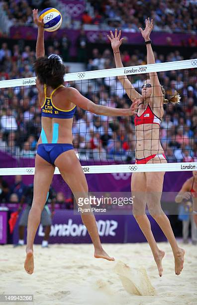 Xi Zhang of China is blocked by Kerri Walsh Jennings of the United States during the Women's Beach Volleyball Semi Final match between United States...