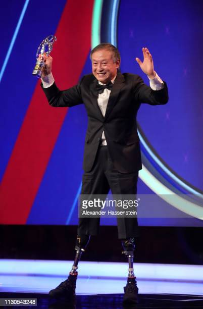 Xia Boyua double amputee who climbed Everest winner of the Laureus Sporting Moment of the Year 2019 celebrates on stage during the 2019 Laureus World...