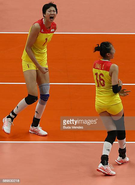 Xia Ding and Xinyue Yuan celebrate a point during the women's qualifying volleyball match between the United States and China at the Maracanazinho...