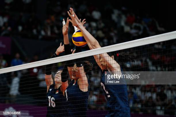 Xia Ding Xinyue Yuan and Zhu Ting of China in action during the Asian Games 2018 Volleyball Women's Gold Medal Match between China and Thailand on...