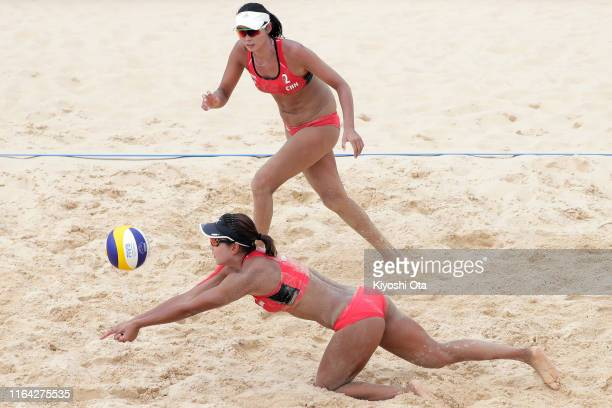 Xia Xinyi and Wang Fan of China compete in the Women's Pool E match against Carolina Salgado and Maria Antonelli of Brazil on day three of the FIVB...