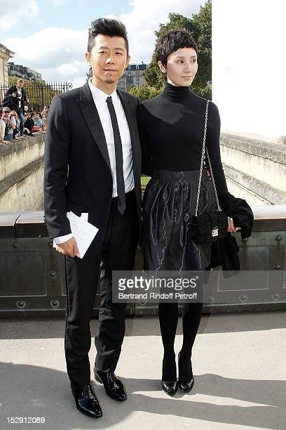 Xia Yu and Yuan Quan attend the Christian Dior Spring / Summer 2013 show as part of Paris Fashion Week on September 28, 2012 in Paris, France.