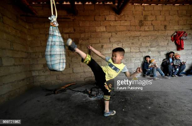Xiaburihai a seven year old boy pratices Kung Fu at home in the liangshan yi autonomous prefecture of China's Sichuan province 23 February 2018...