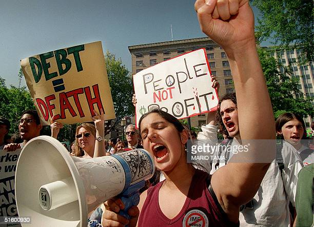 Xiah Kragie of Silver Spring, Maryland, protests along with hundreds of others outside the World Bank/IMF spring meetings 29 April in Washington, DC....