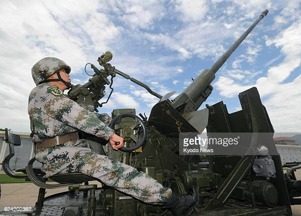 Xi'an China China's People's Liberation Army shows reporters a mock firing drill for antiaircraft guns in the suburbs of Xi'an Shaanxi Province on...