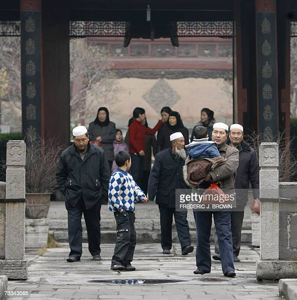Hui Muslims arrive at the Great Mosque in Xian's Muslim quarter 07 February 2007 in Xian capital of northwest China's Shaanxi province For many of...