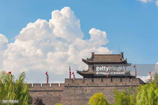 xian city wall against blue sky and white clouds - pagoda stock pictures, royalty-free photos & images