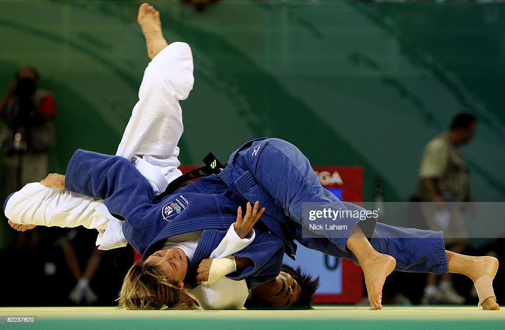 Xian Dongmei (in white) of China competes against Telma Monteiro of Portugal in their -52 kg women's preliminary judo event held during day 2 of the Beijing 2008 Olympic Games at the University of Science and Technology Beijing Gymnasium on August 10, 2008 in Beijing, China. Xian won the bout.